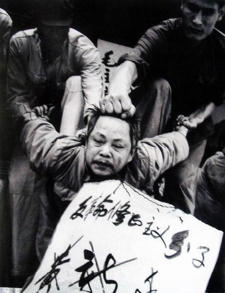 "HONG KONG, CHINA: An undated picture from the documentary film ""Morning Sun"" shows Huang Xinting, the commander of the Chengdu Military Region, being struggled against at his headquarters in 1967, the victim being forced to bow forward while his arms are twisted and bent back at an impossible angle--called ""doing the jet plane"". The film by Carma Hinton, 53, the China-born daughter of an American Maoist and co-directed with her husband Richard Gordon and Australian academic Geremie Barme, show the early decades of communist rule. AFP PHOTO (Photo credit should read -/AFP/Getty Images)"
